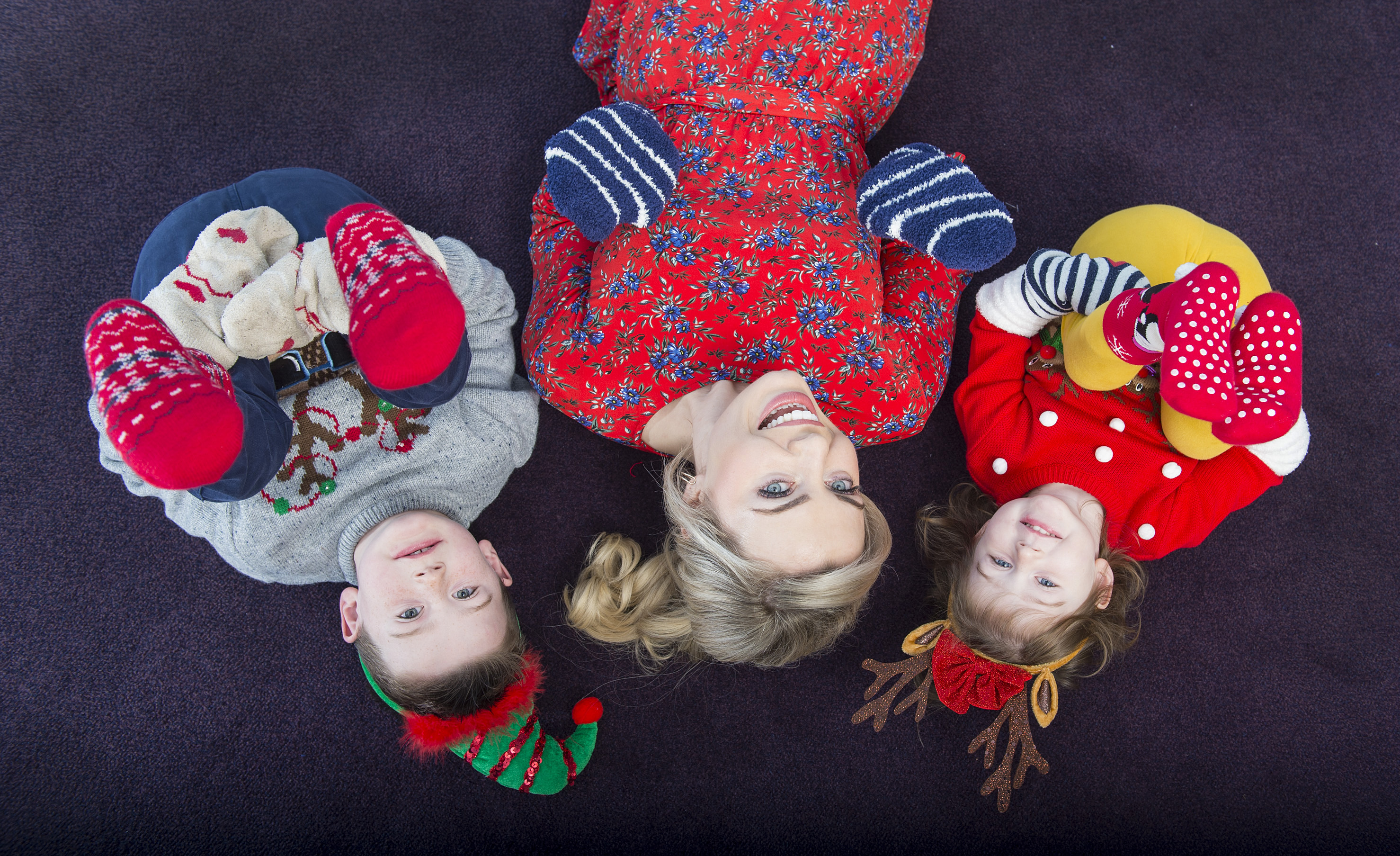 Anna Geary Pulls Up her Christmas Socks for CUH Children's
